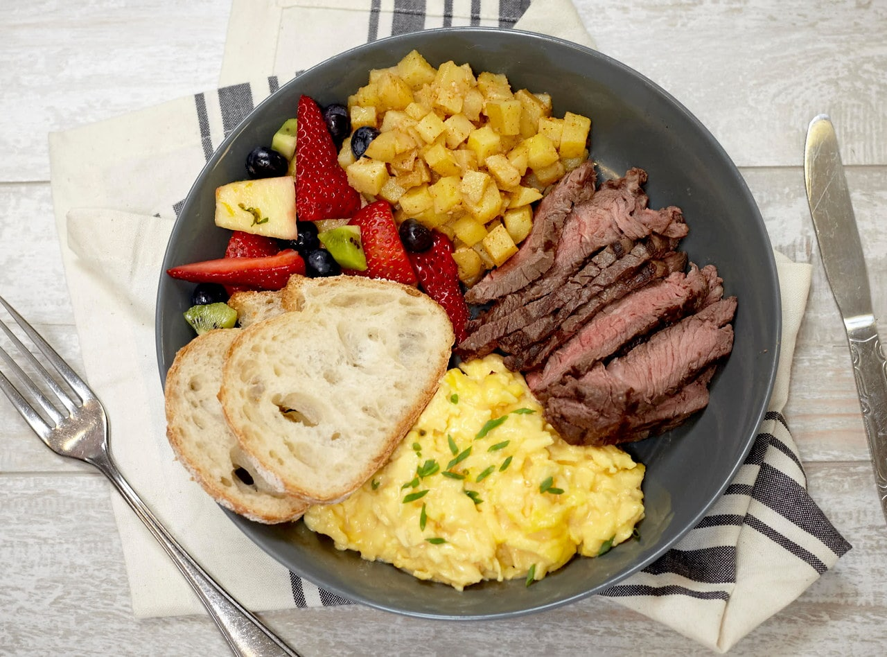 Cheesy Eggs, Grilled Flank Steak, and Roasted Potatoes by Chef Natalie Lamberjack
